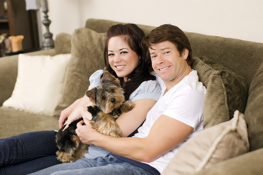 Young-couple-lounging-on-their-sofa